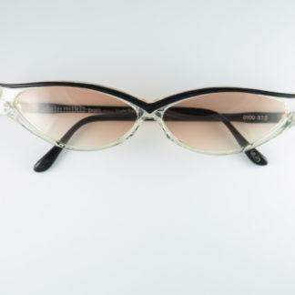 En 1978, à l'âge de 23 ans, Alain Mikli fonde son entreprise de création de lunettes à Paris2. En 1984, il lance une ligne de lunettes pour Claude Montana et Anne-Marie Beretta3. Depuis 1996, il collabore avec Philippe Starck. Ils ont créé ensemble la marque Starck Eyes dont la principale caractéristique vient d'une charnière sans vis, à l'image d'une clavicule humaine4. Depuis 2010, après le rachat fin 2009 de la société Sporoptic Pouilloux, détentrice de la marque de lunettes de soleil et de masques de ski Vuarnet, son entreprise est touchée par la baisse du marché de l'optique et un contexte économique morose en Europe et en Amérique du Nord5. Fin 2012, le groupe italien Luxottica, numéro un mondial de la lunette, rachète son entreprise6.